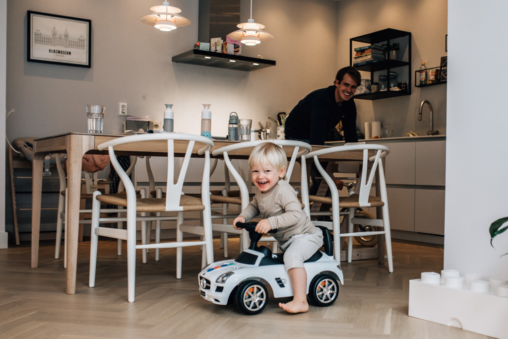 Toddler playing with his dad in the kitchen
